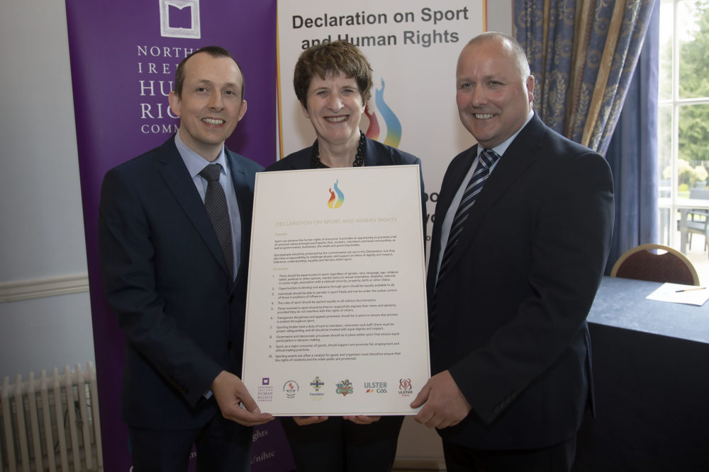 <p>NIHRC Chief Executive, Dr David Russell; UN Deputy High Commissioner on Human Rights, Kate Gilmore; and NI Sport & Human Rights Forum Chair, Conal Heatley (NI Commonwealth Games Council) at the 2019 launch of the Declaration on Sport & Human Rights</p>